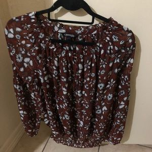 Brown blouse with flower designs.